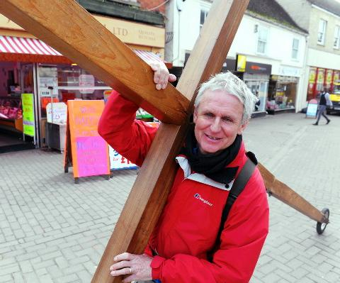 Lindsay Hamon with his cross in Parsonage Street, Dursley on Tuesday, March 19