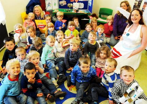 Dentist 'tooth fairy' Gemma Allen with the children at Woodfield Nest during her talk about dental health