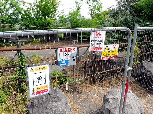 Warnings issued over danger of swimming in quarry  water