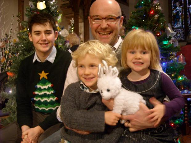 BBC Radio Gloucestershire traffic presenter Jack Miles and presenter Chris Baxter with his children William, five and Dorothy, three