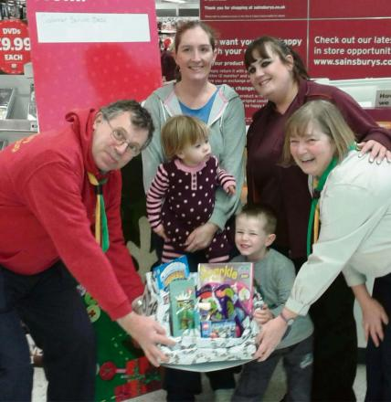 Maisie, and George Pitts with mum Emma Beach (middle) being given the Christmas trail prizes by 1st Dursley Scout leader John fleck, Beaver scout leader Maggie Sweeting and Sainsbury's representative Nikova Davies (3277082)