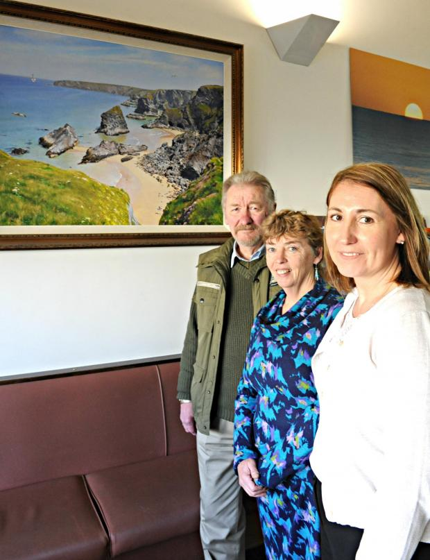Gazette Series: Artist Barry Walding with Dr Susan Green and Caroline Pearmain, Practise Manager at Culverhay Surgery in Wotton-under-Edge an