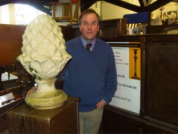 Philip Taubenheim from Wotton Auction rooms with a stone pineapple th