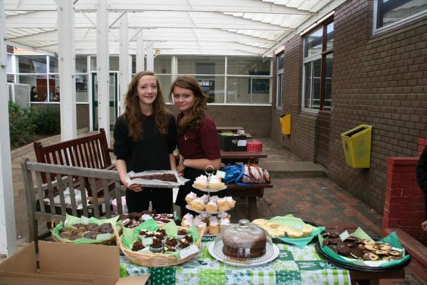 Molly and her friend Sophie Templar manning the stall on the day of the cake sale