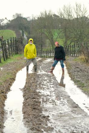 Councillors Dave and Pat Hockey on the muddy path used by Winterbourne International Academy students