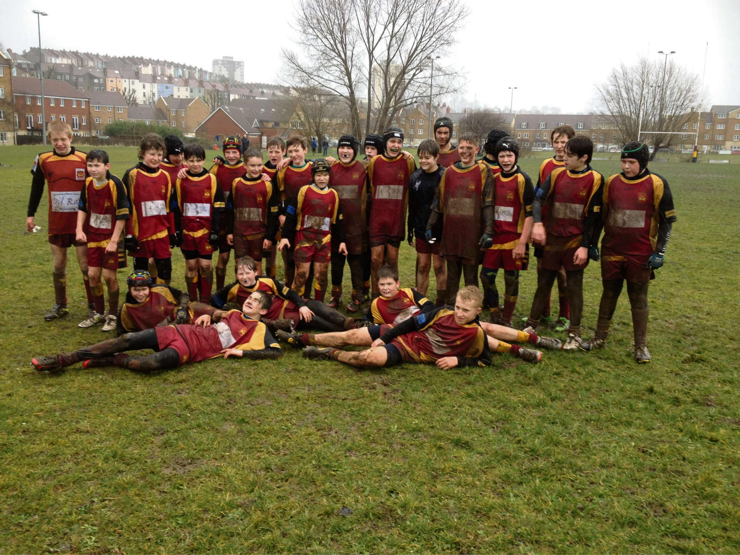 Dursley under-13s celebrate their win in the mud (3680881)