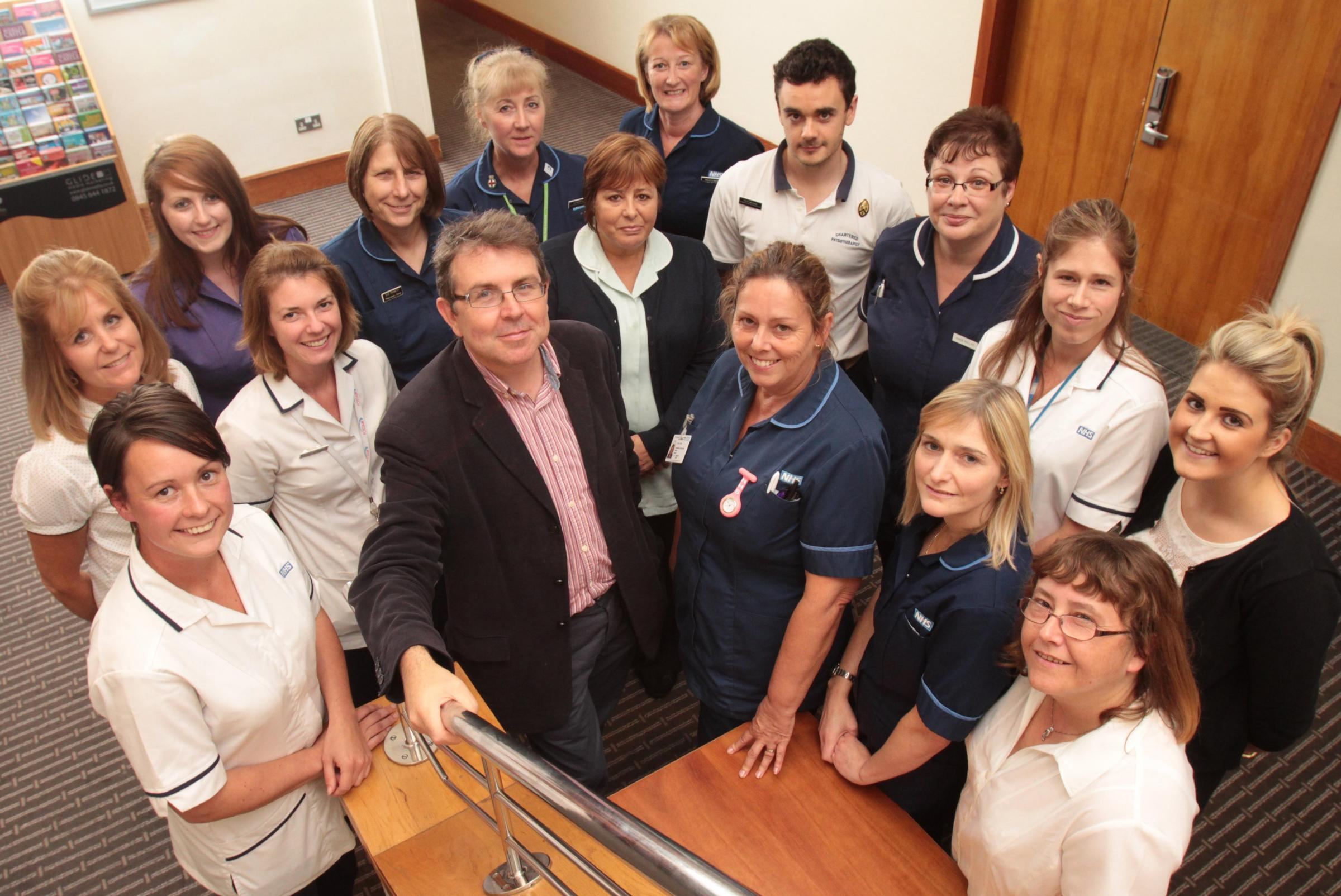 Dr Andrew White (centre) with some of the new Gloucestershire Respiratory Team. Picture by Antony Thompson - Thousand Word Media.