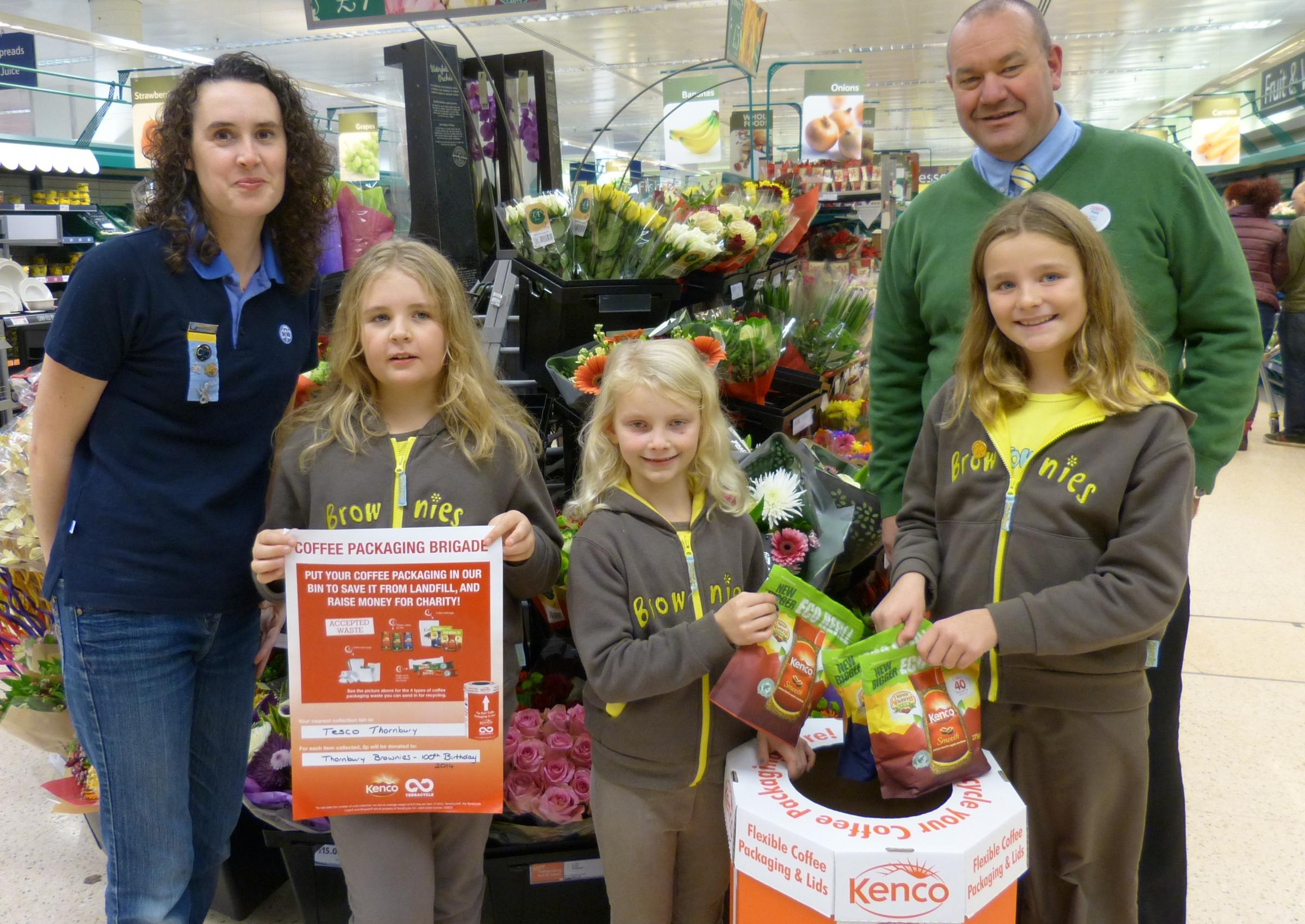 Pictured (left to right): Lisa Phillips (administrator), Katy Curtis, Mia Vowles, Grace Hutchinson and Pete Baines (Deputy Store Manager) with the Thornbury Coffee Packaging Brigade collection box situated at the Tesco store on Midland Way.  (3553381)