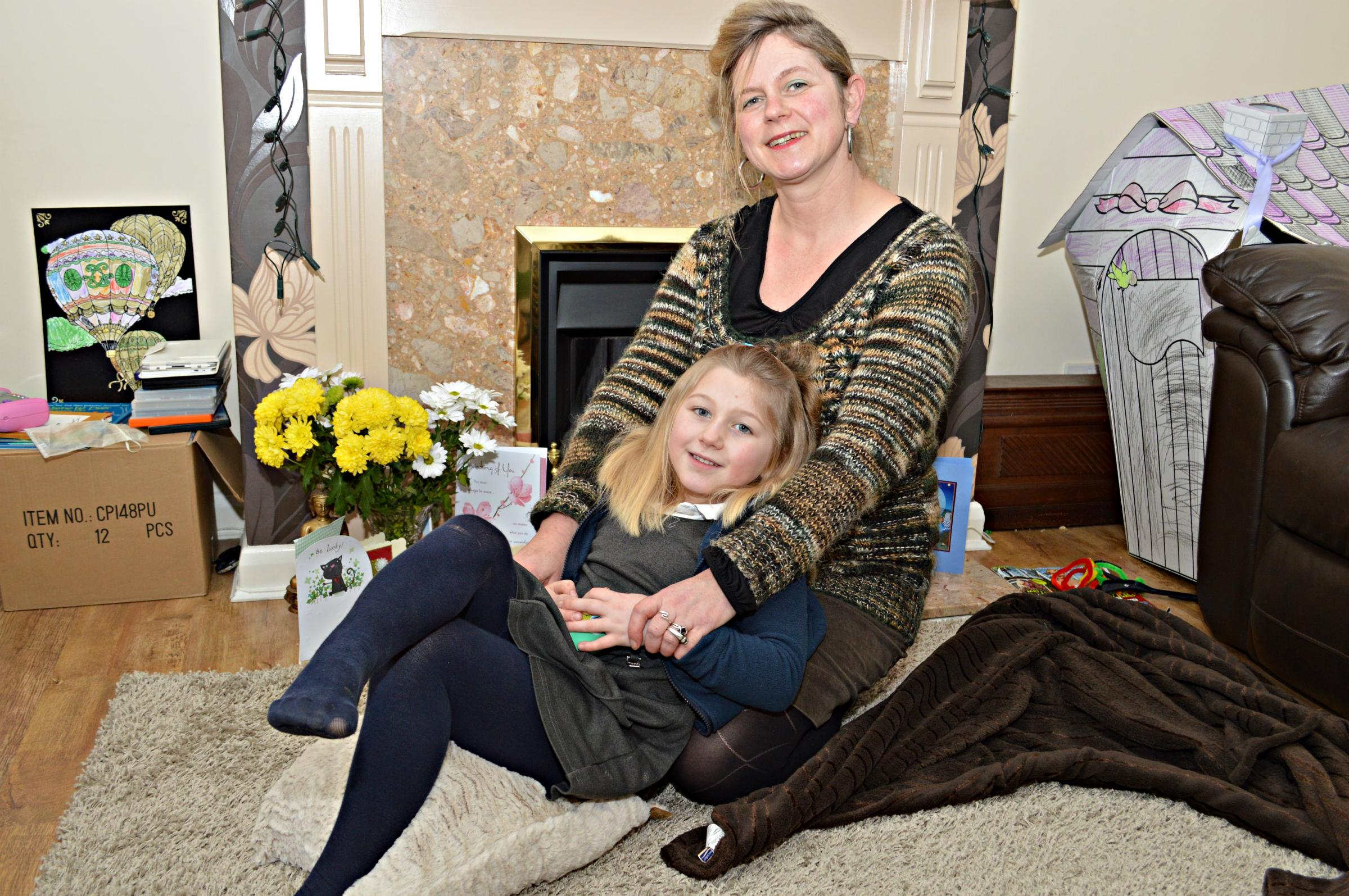 Claire Little, known as Barny to her friends and family, at home with five-year-old daughter Rosalia