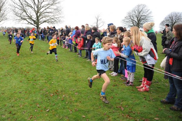 Gazette Series: Competitors in the Junior Boys race at the district cross country final head towards the finish line