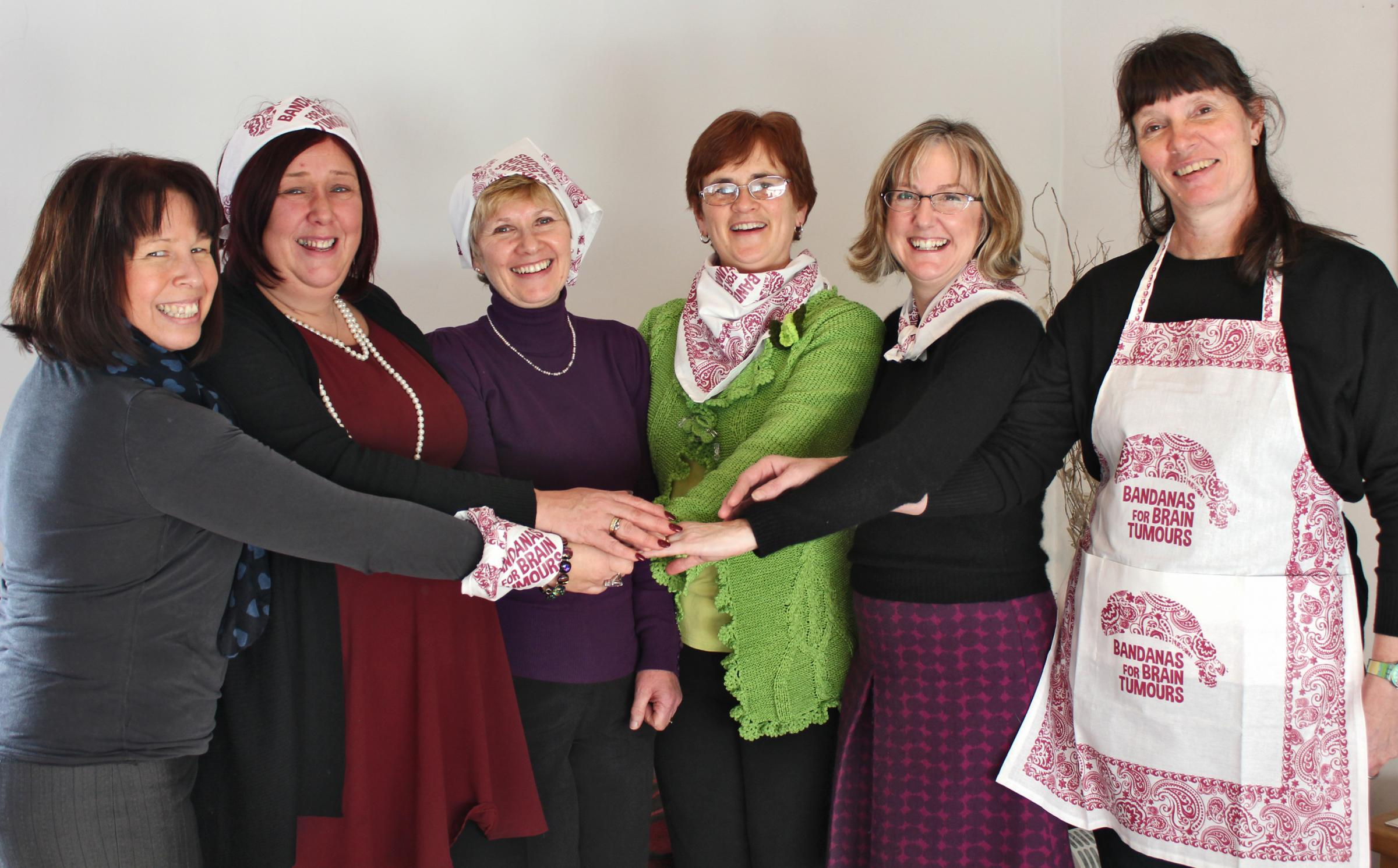 The Hammer Out team (from left)  Founder and CEO Tina Mitchell Skinner, Helen Silverthorn, Gill Chester, Rosemary Wormington, Joanna Instone and Steph Staton get  ready for Bandanas for Brain Tumours Day.