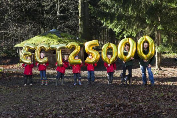 Hatherop Castle School pupil's celebrating 25,000th child visit with education officers Anne Newman and Peter Tatham at the Ernest Cook Trust's Fairford estate.