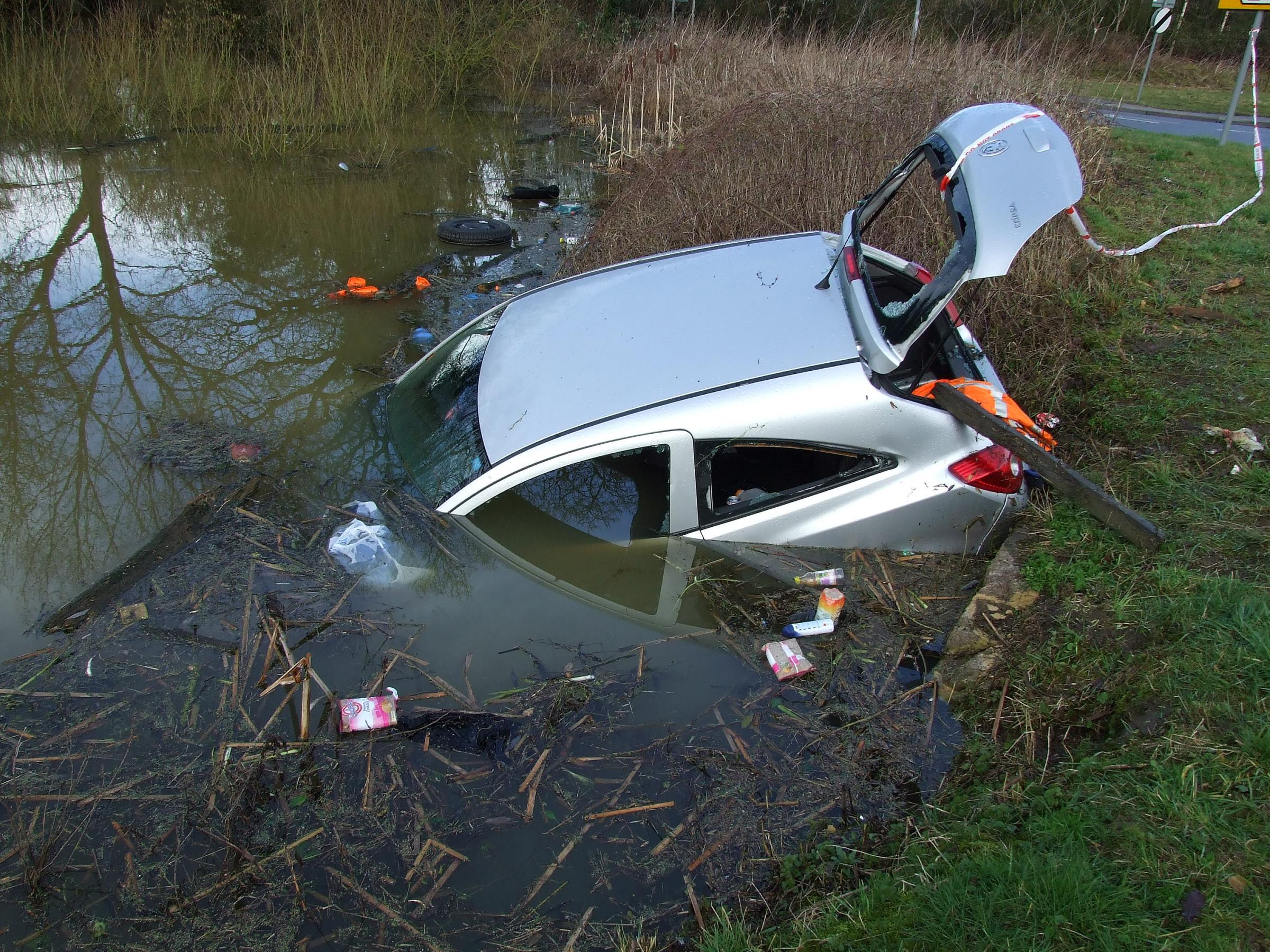 Two men escape from car after it plunges into water near Ashton Keynes