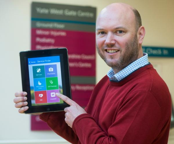 Dr Jonathan Hayes with the new health services app