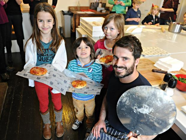 Fabulous Baker Brother Tom Herbert with children at the Hobbs House pizza workshop