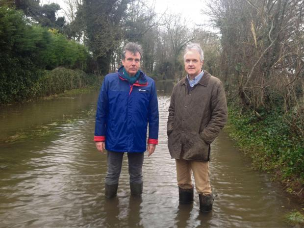Gazette Series: Stroud MP Neil Carmichael and Cllr Haydn Jones, representative for the Severn Ward on Stroud District Council at the flooded site in Frampton on Severn (4078208)