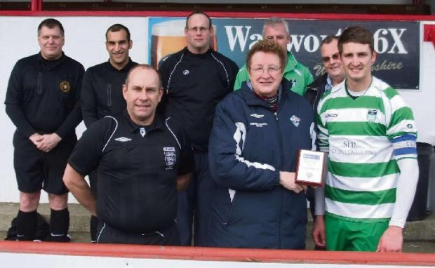 Sue Merrill, Western League director, presents the initial RESPECT award to Almondsbury UWE captain Neil Bailey, watched over by club members and match officials