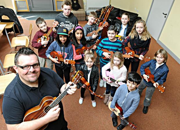 Dan Budd with some of the youngsters at his Ukelele jam sessions at the Krunch youth centre in Thornbury (4222722)