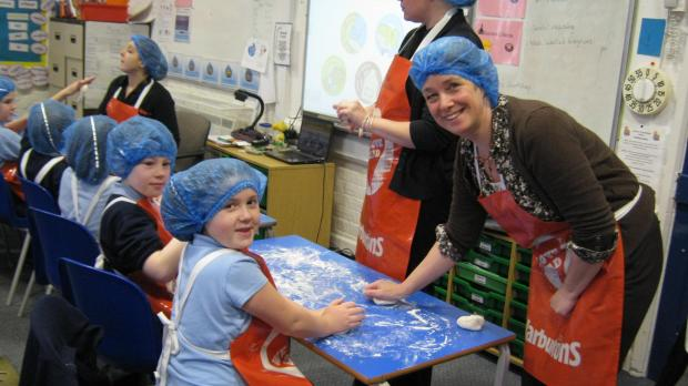 Gazette Series: Hillesley Primary pupils enjoyed getting stuck into the baking process (4245561)