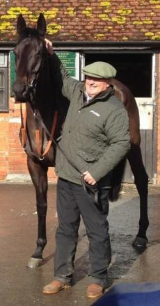 Big Buck's, who is going for a record fifth win in the Ladbrokes World Hurdle at the Cheltenham Festival and his trainer Paul Nicholls