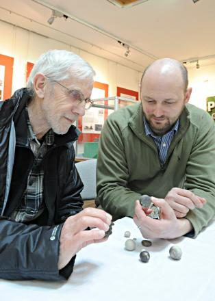 Kurt Adams, right, looking at Tony Flood's dinosaur vertebrae which he brought to the archaelogy finds day at Yate Heritage Centre