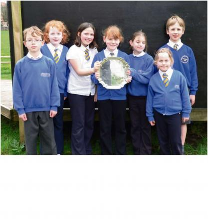 Students from St Mary's Church of England Primary School with the Connexions Plate Trophy  they won for the
