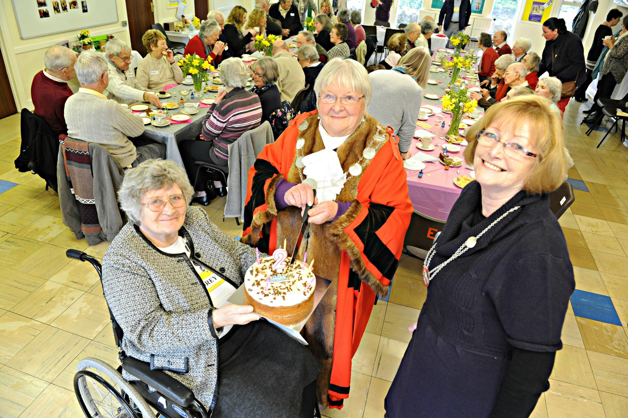 Audrey Green chairman of the Thornbury Memory Cafe with  Mayor of Thornbury  Cllr Pam Shipp and her Consort Valerie Vizard and a celebration cake for the groups 2nd anniversary  (4532712)