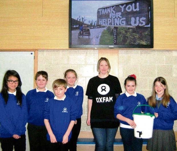 Gillingstool Primary School Year 6 school councillors with Oxfam's Alice Byron and pupils Leah Bishop and Freya Maidstone who launched the fundraising campaign (4655576)