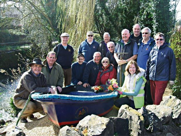 Members of Sodbury in Bloom and Chipping Sodbury Yacht Club launch the new boat