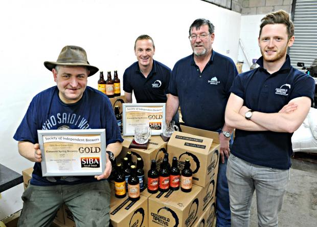 Nik Milo, Mark Frankcom, Steve McDonald and Sam Evanson, of Cotswold Spring Brewery, with their Supreme Gold Champion award which they won with their Old Sodbury Mild at the National Beer Awards