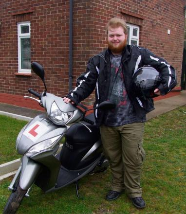 Brandon Rowat with his new scooter  (4930061)