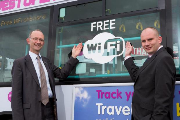 Gazette Series: Paul Matthews, left, managing director of  First West of England with commercial manager Simon Ford standing by a bus fitted with free wi-fi.(4942043)