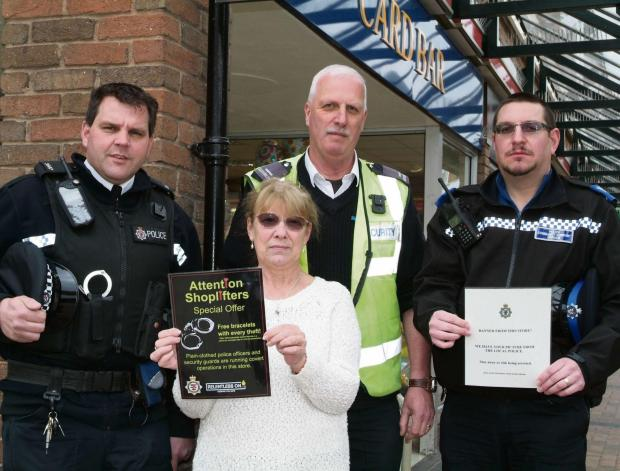 PC Sean White, Marlyn O'Sullivan, Malcolm Kitteringham and PCSO Tony Blackmore outside the Card Bar store in the St Mary Centre, Thornbury  (4987334)