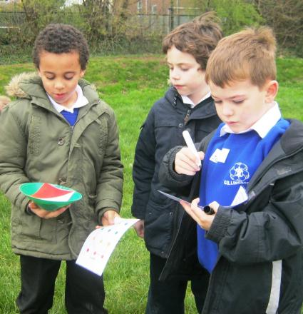 Year two pupils Leshon Lee, of Gillingstool School, Louis Bloodworth, of St Mary's School, and James Trueman, of Gillingstool School, taking part in the orienteering event. (4947084)