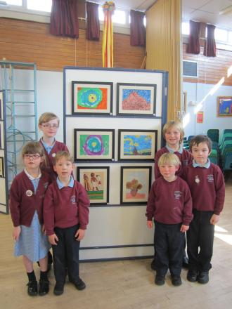 Manorbrook Primary School pupils Erin, Shannon, Henry, Baileigh, Ewan and James next to their work in the school exhibition.                (4993626)