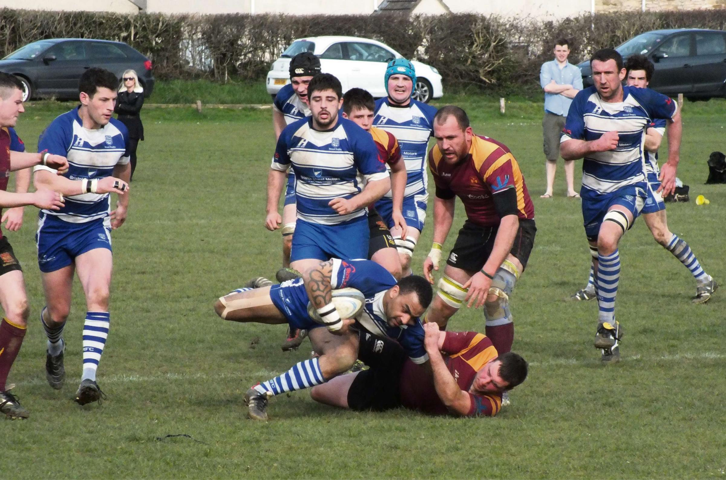 Dursley's Simon Camm brings down Dan Gordan of Stroud with captain Scott Udal standing over them. Picture by Trevor Hodges.