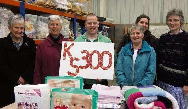 Gazette Series: Some of the Kids' Stuff team, with manager Will Mansell, in the centre, in the warehouse  (5010433)