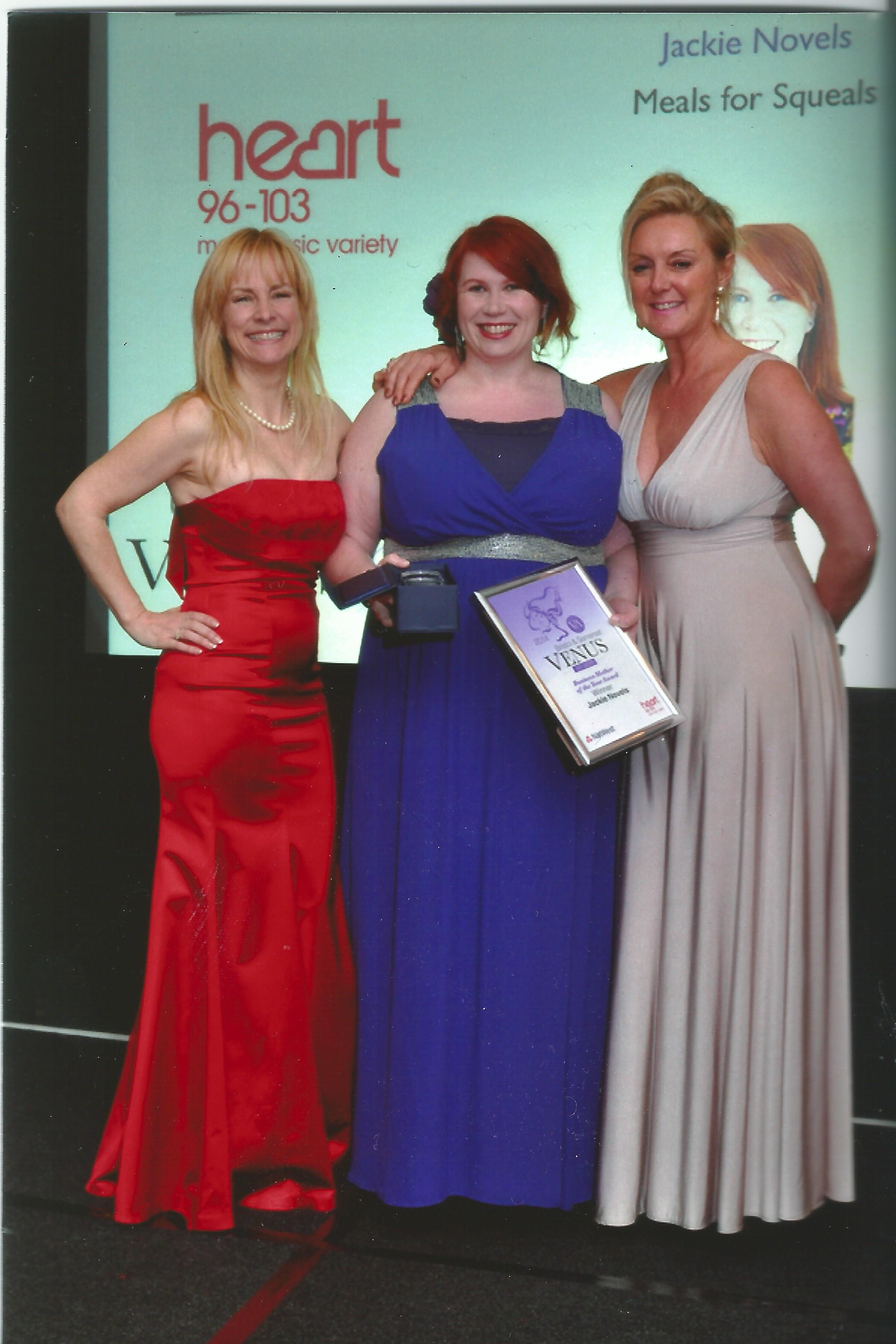 Jackie Novels is presented with her award by Paulina Gillespie, from Heart FM, and Tara Howard, founder of the Venus Awards