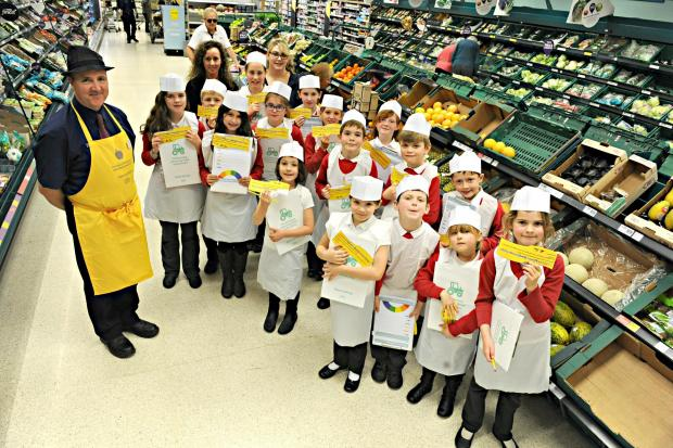 Darren McMillan, Farm to Fork supervisor at Tesco's in Cam with pupils from Dursley Primary Academy during the healthy eating visit on Tuesday (5035182)