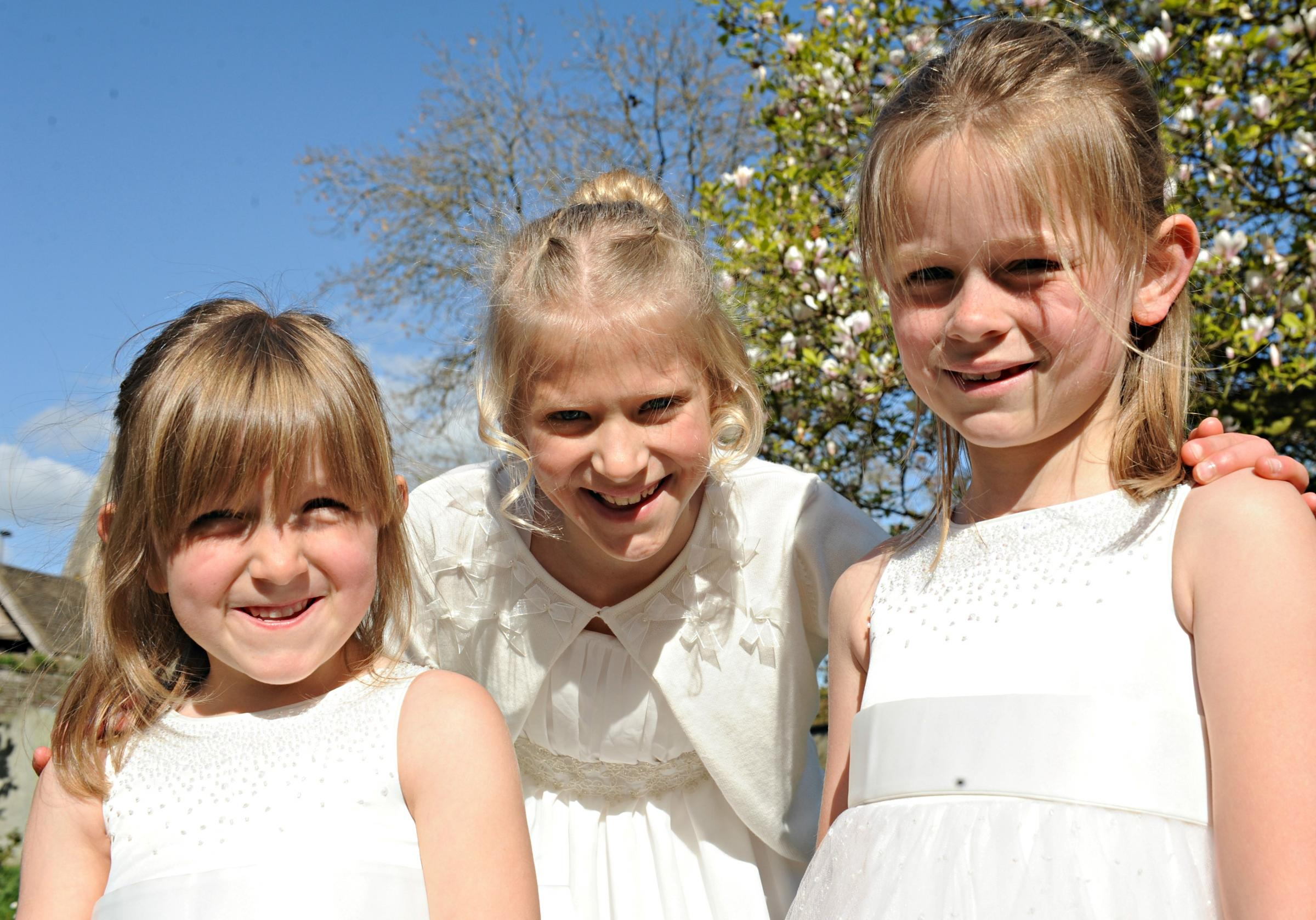 Winterbourne Down May Queen Charlotte Anstey, 9, centre, with her attendants Madeleine Allchorne,7, and Evie Allchorne,5