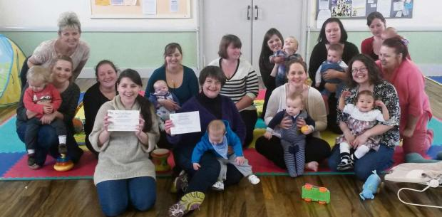 Volunteers Diz Pedrick and Anja Rowston show off their level two paediatric first aid certificates with members of Stinchcombe Baby Cafe (5396471)