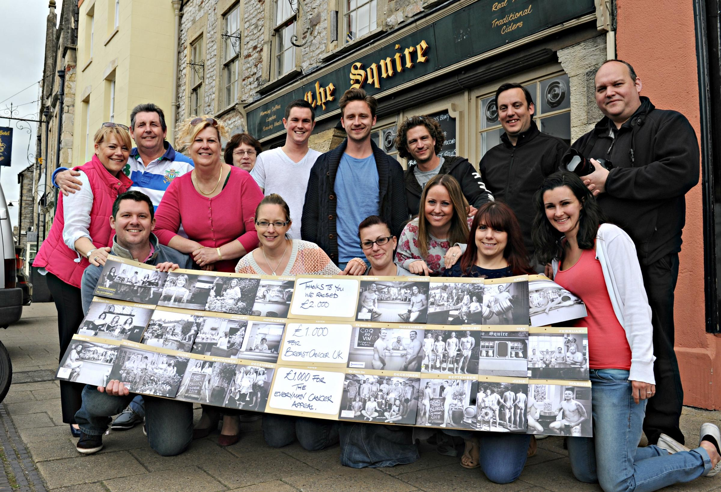 Customers and staff of the The Squire in Chipping Sodbury who have raised £2,000 for charity from the sale of their naked calendars