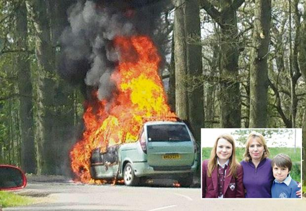 Gazette Series: Helen Clements with her children Charlie,12, and George,9, (inset) with their car burning in the lion enclosure at Longleat (5591880)