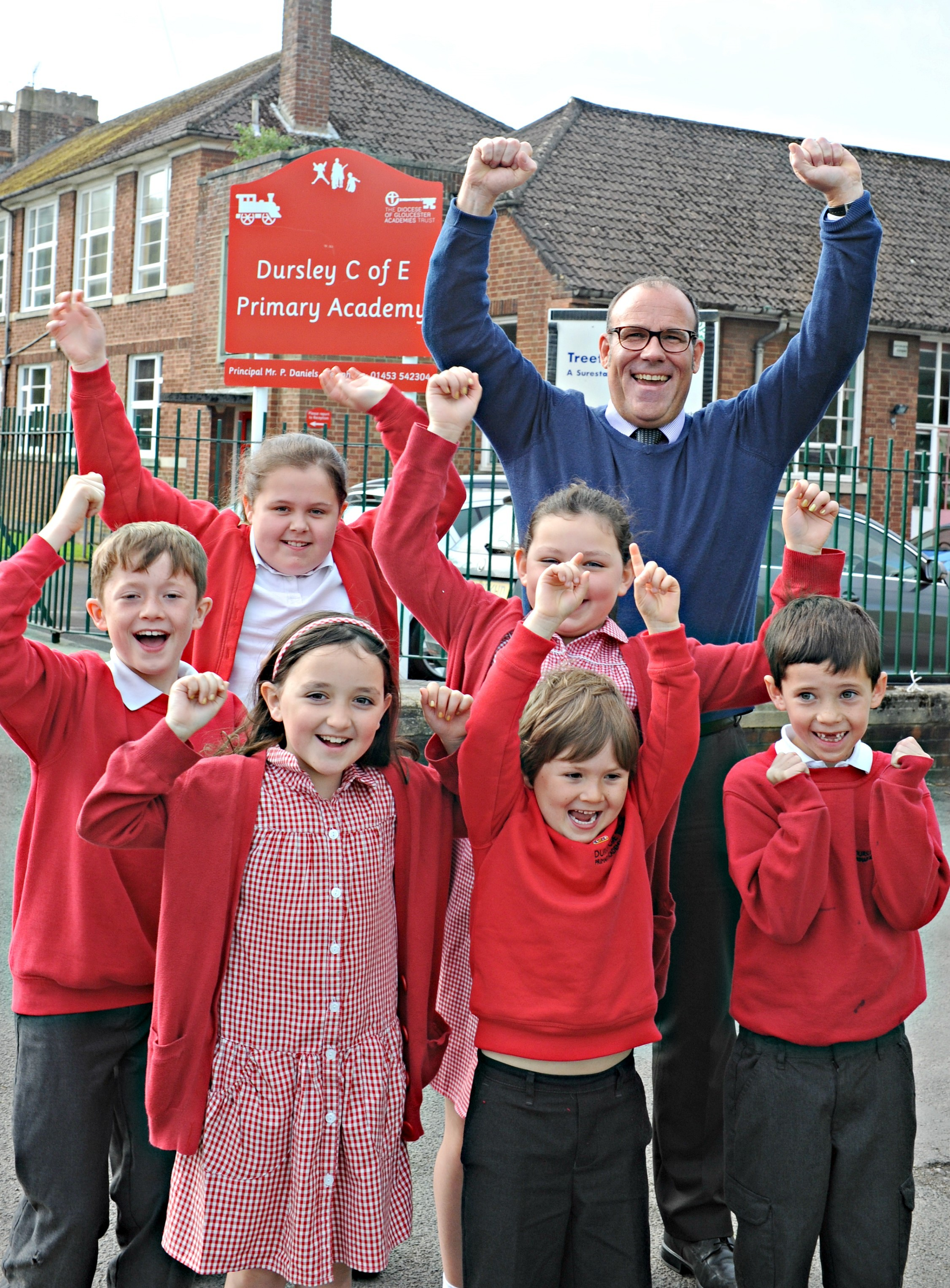 Dursley Primary Academy head teacher Paul Daniels with some of his pupils celebrating the school's maintenance grant (5989357)