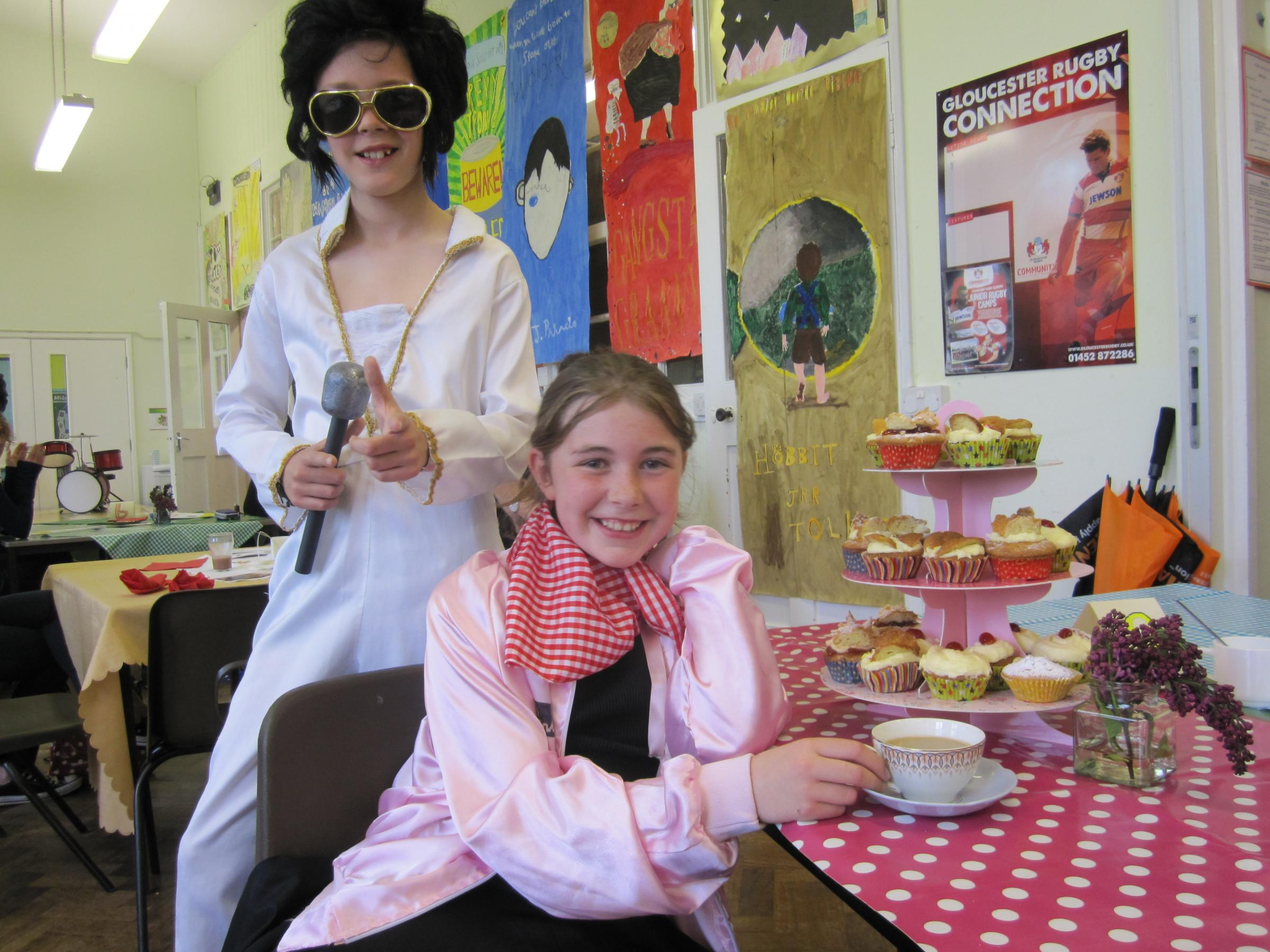 Roller-skating waitress Rebecca Jones with George Eden dressed as Elvis Presley at Uley Primary School's fundraising retro cafe (5958434)