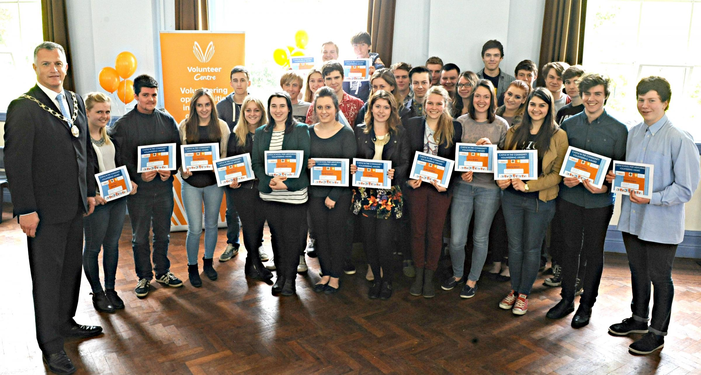 Cllr Ian Boulton, Chairman of South Gloucestershire Council with Castle School sixth form students after he presented awards to students taking part in the Castle School Community Scheme run with Thornbury Volunteer Centre (6007659)