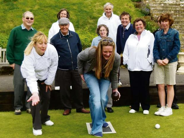 Gazette Series: Club coach Gill Meadows (front left) demonstrating to a group of some of those who attended the Dursley Bowls Club Open Day afternoon on Saturday