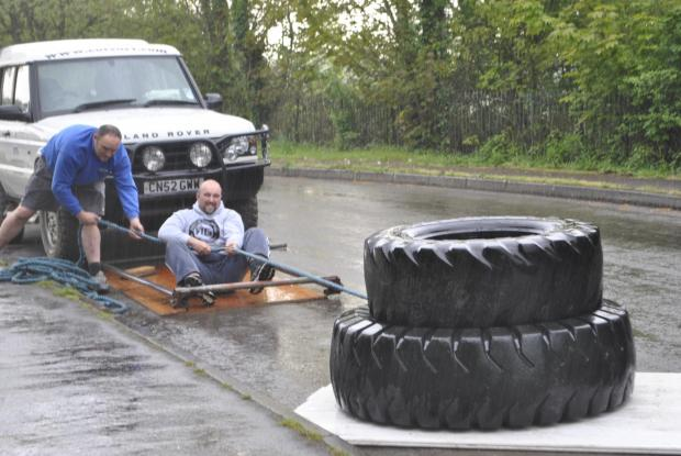 Competitor Matthew Vaughan practises dragging two monster tyres up Oldminster Road before the big event on Sunday (6345833)