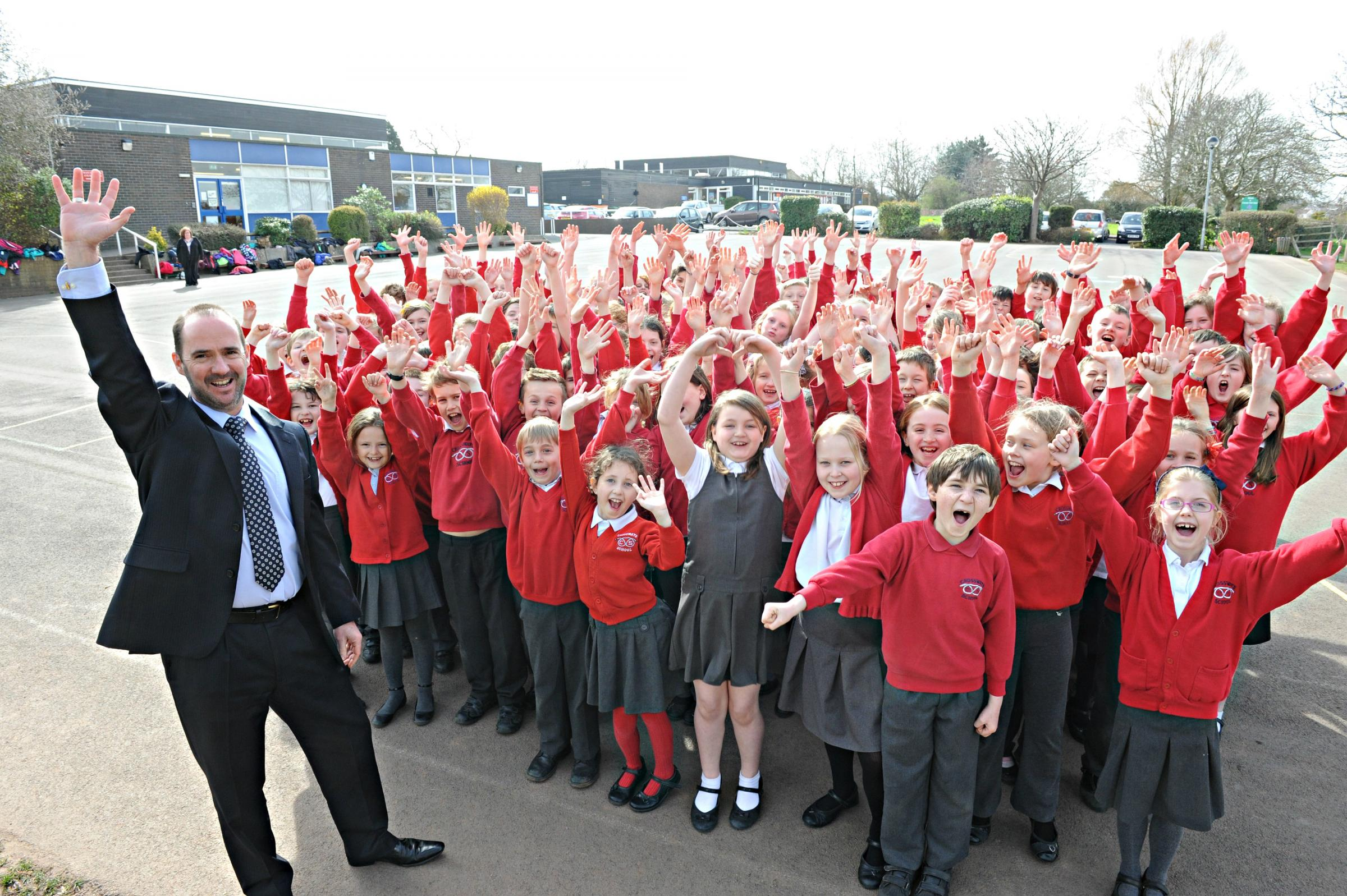 Headteacher Mark Toogood celebrating Crossways Junior School's Ofsted report with Year 4 and 5 pupils