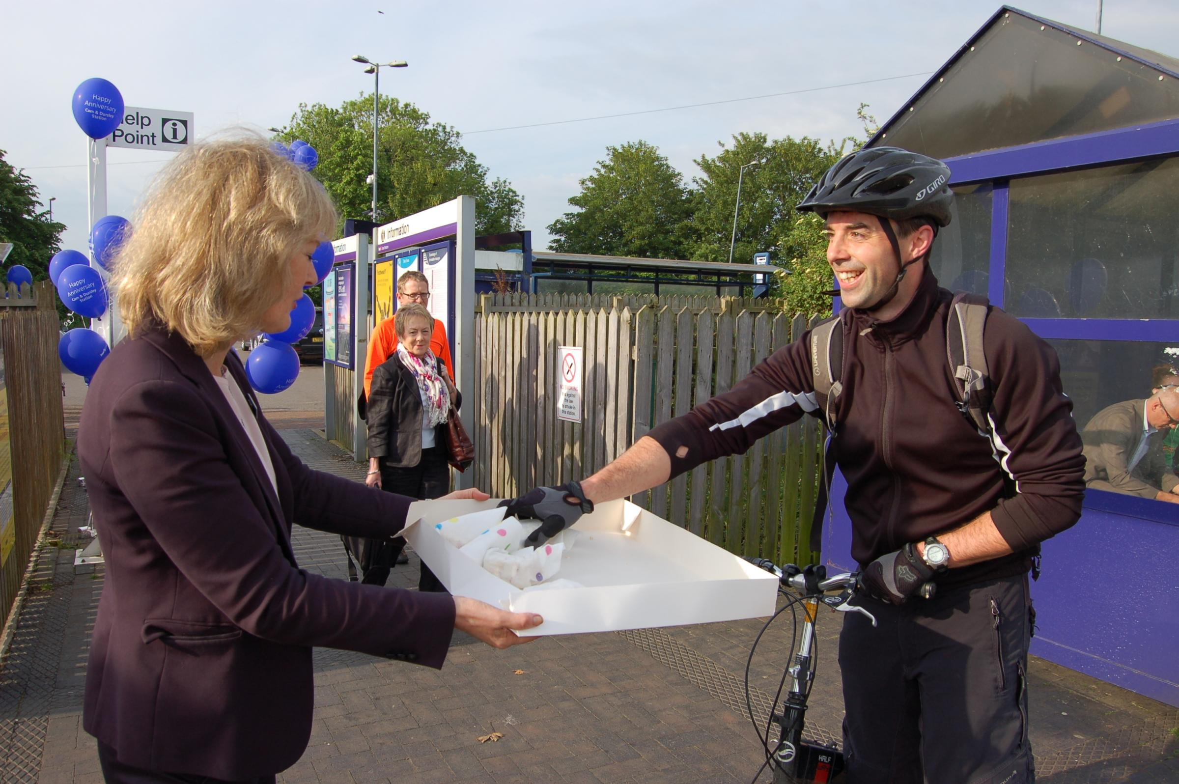 Cam and Dursley station manager Linda Swainger hands out birthday cake to one happy commuter as the station enjoys its 20th year in operation. Photo by Robert Harris.(6385931)